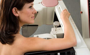Patient having breast scan in hospital, profile